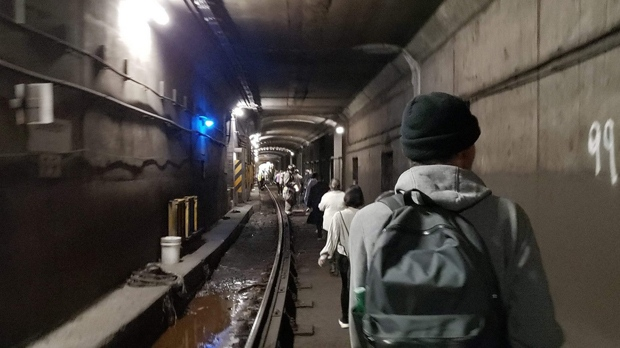 Passengers from a disabled subway train walk in the tunnel leading to Union Station on June 5, 2019. (Julien Chagnon-Zimmerly)