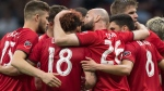 Toronto FC's Laurent Ciman (26) kisses Nick DeLeon (18) as they celebrate DeLeon's goal against the Vancouver Whitecaps during the second half of an MLS soccer game in Vancouver on Friday May 31, 2019. THE CANADIAN PRESS/Darryl Dyck