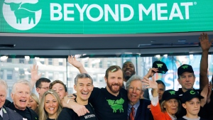 In this May 2, 2019, file photo Ethan Brown, center, CEO of Beyond Meat, attends the Opening Bell ceremony with guests to celebrate the company's IPO at Nasdaq in New York. (AP Photo/Mark Lennihan, File)