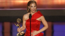 Gina Tognoni accepts the award for outstanding supporting actress in a drama series for her work on 'Guiding Light' at the 35th Annual Daytime Emmy Awards in Los Angeles on Friday, June 20, 2008. (AP / Matt Sayles)