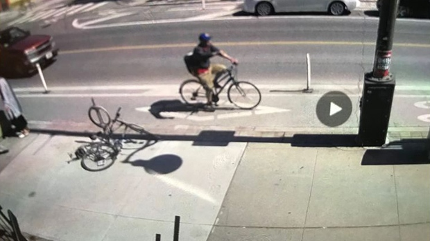 A cyclist wanted in an assault investigating involving a baby is seen in a surveillance camera image. (TPS)