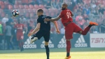 Sporting Kansas City defender Andreu Fontas (4) and Toronto FC forward Terrence Boyd (91) battle for the ball during first half MLS soccer action at BMO field in Toronto, Friday, June 7, 2019. THE CANADIAN PRESS/Cole Burston