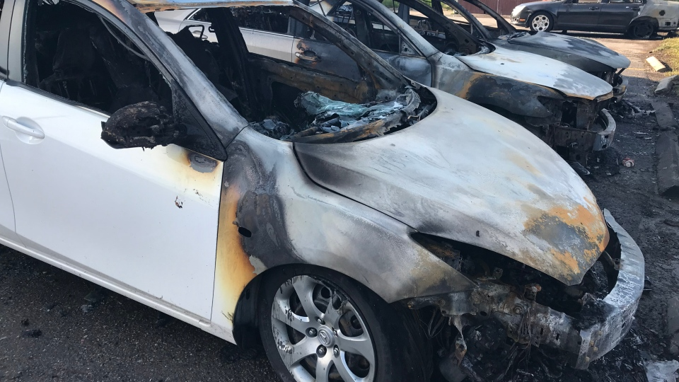 Burned-out vehicles are pictured at the scene of a fire on Bloor Street in Oshawa Sunday June 9, 2019. (Brandon Gonez /CP24)
