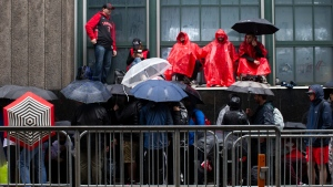 Toronto Raptors fans line up outside the Scotiabank Arena, in Toronto on Monday, June 10, 2019, to gain access to the fan area known as 'Jurassic Park' ahead of game five of the NBA Finals between the Toronto Raptors ad Golden State Warriors. THE CANADIAN PRESS/Chris Young