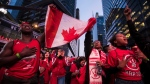 "Toronto Raptors fans sing the Canadian national anthem outside the Scotiabank Arena, at what's dubbed ""Jurassic Park,"" during the NBA finals debut against the Golden State Warriors in Toronto on Thursday, May 30, 2019. THE CANADIAN PRESS/Tijana Martin"