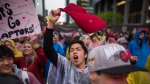 Raptors fans cheer from the Jurassic Park fanzone outside of Scotiabank Arena ahead of Game 5 of the NBA Final between Toronto Raptors and Golden State Warriors in Toronto Monday, June 10, 2019. THE CANADIAN PRESS/ Tijana Martin