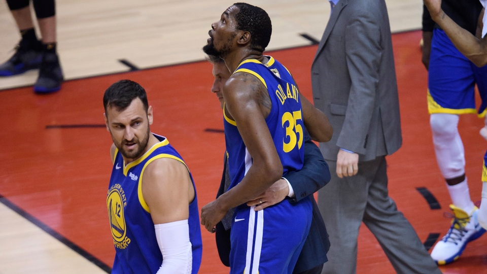 Golden State Warriors forward Kevin Durant (35) leaves the game injured while playing against the Toronto Raptors during first half Game 5 NBA Finals basketball action in Toronto on Monday, June 10, 2019. THE CANADIAN PRESS/Nathan Denette
