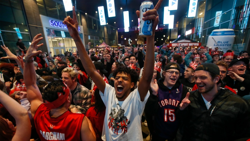 Toronto Raptors fans cheer at Rogers Square at a public viewing of game five of the NBA Finals between the Raptors and the Golden State Warriors in Halifax, Monday, June 10, 2019. THE CANADIAN PRESS/Tim Krochak