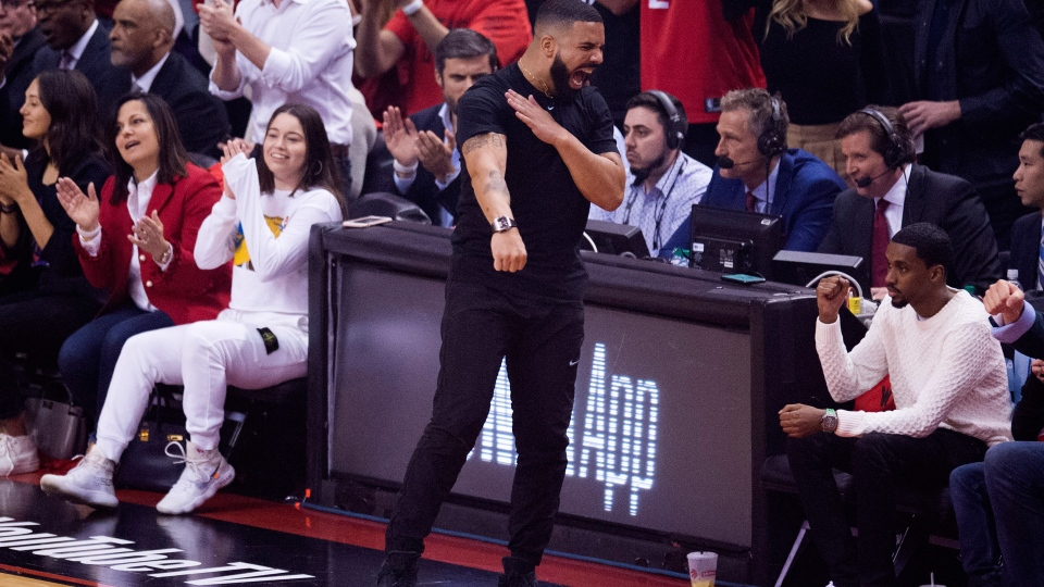 Performing artist Drake celebrates on the sidelines during first half basketball action in Game 5 of the NBA Finals between the Toronto Raptors and the Golden State Warriors in Toronto on Monday, June 10, 2019. THE CANADIAN PRESS/Chris Young