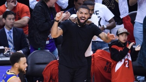 Rapper Drake yells at Golden State Warriors players while playing against the Toronto Raptors during first half Game 5 NBA Finals basketball action in Toronto on Monday, June 10, 2019. THE CANADIAN PRESS/Nathan Denette