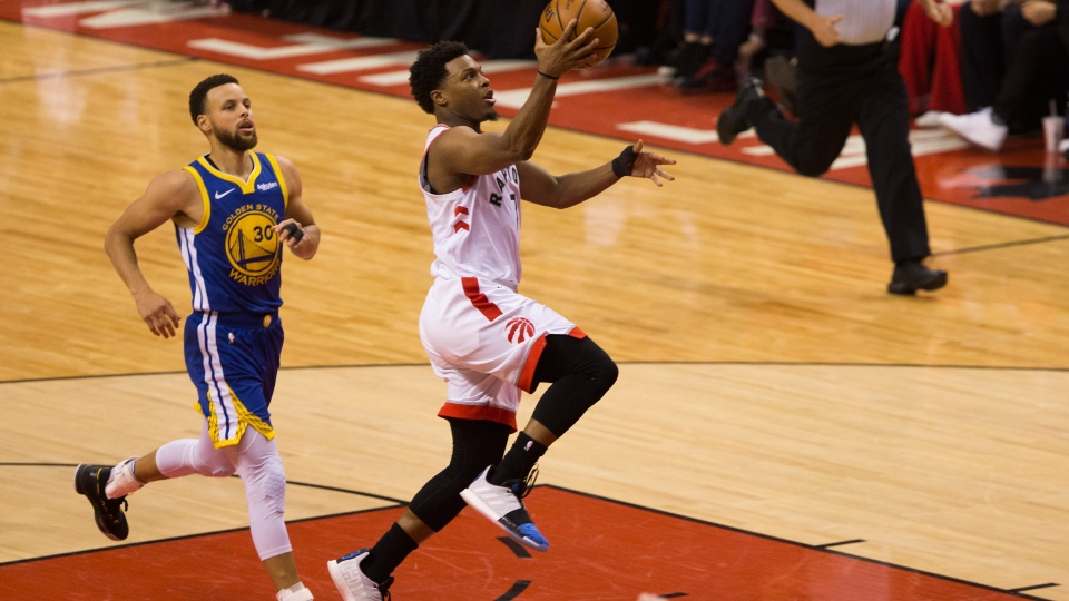 Toronto Raptors guard Kyle Lowry (7) scores ahead of Golden State Warriors guard Stephen Curry (30) during first half basketball action in Game 5 of the NBA Finals in Toronto on Monday, June 10, 2019. THE CANADIAN PRESS/Chris Young