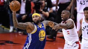 Golden State Warriors centre DeMarcus Cousins (0) grabs a rebound in front of Toronto Raptors centre Serge Ibaka (9) during second half basketball action in Game 5 of the NBA Finals in Toronto on Monday, June 10, 2019. THE CANADIAN PRESS/Frank Gunn