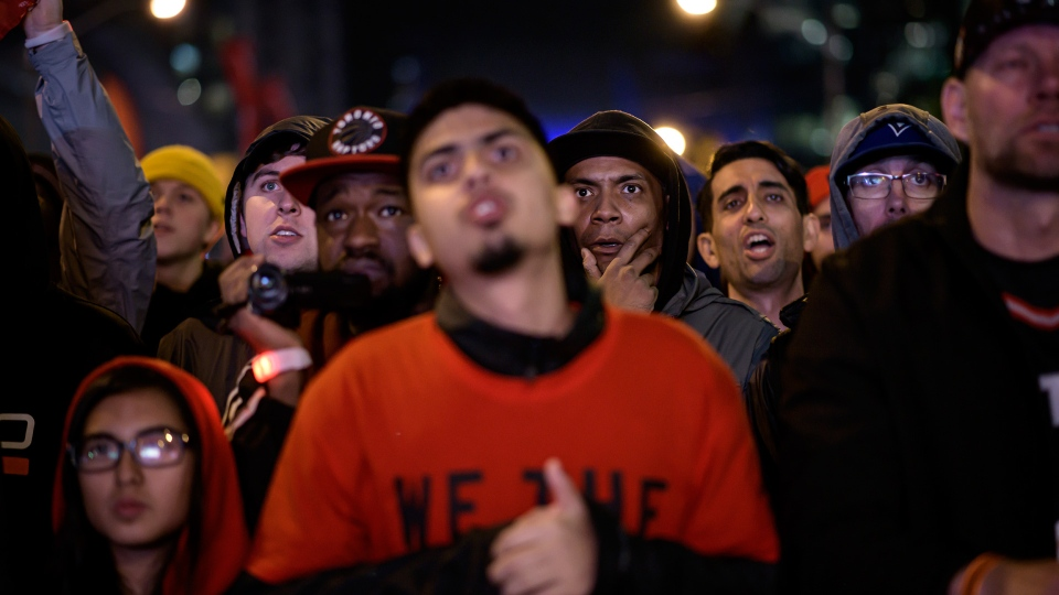 Raptors fans react outside of Scotiabank Arena during Game 5 of the NBA Final between Toronto Raptors and Golden State Warriors in Toronto Monday, June 10, 2019. THE CANADIAN PRESS/Christopher Katsarov