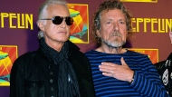 """In this Oct. 9, 2012 file photo, Led Zeppelin guitarist Jimmy Page, left, and singer Robert Plant appear at a news conference ahead of the worldwide theatrical release of """"Celebration Day,"""" a concert film of their 2007 London O2 arena reunion show, in New York. A panel of 11 judges from the 9th U.S. Circuit Court of Appeals agreed Monday, June 10, 2019, to hear Led Zeppelin's appeal in a copyright lawsuit alleging the group stole its 1971 rock epic from an obscure 1960s instrumental. (Photo by Evan Agostini/Invision/AP, File)"""