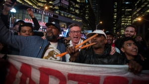 Mayor John Tory, centre, joins Raptors fans at the Jurassic Park fanzone outside of Scotiabank Arena at halftime during game Game 5 of the NBA Final between Toronto Raptors and Golden State Warriors in Toronto Monday, June 10, 2019. THE CANADIAN PRESS/ Tijana Martin