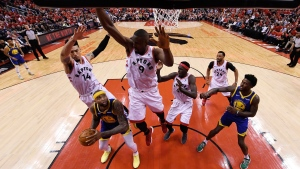 Golden State Warriors centre DeMarcus Cousins (0) looks to shoot as Toronto Raptors guard Danny Green (14) and centre Serge Ibaka (9) defend as forward Pascal Siakam (43), forward Norman Powell (24) and Warriors forward Jordan Bell (2) look on during second half basketball action in Game 5 of the NBA Finals in Toronto on Monday, June 10, 2019. THE CANADIAN PRESS/Kyle Terada