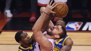 Toronto Raptors centre Marc Gasol (33) gets fouled by Golden State Warriors forward Kevin Durant (35) during first half Game 5 NBA Finals basketball action in Toronto on Monday, June 10, 2019. THE CANADIAN PRESS/Nathan Denette