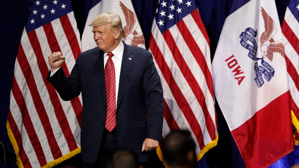 President Donald Trump acknowledges supporters after speaking at the Republican Party of Iowa's America First Dinner, Tuesday, June 11, 2019, in West Des Moines, Iowa. (AP Photo/Charlie Neibergall)
