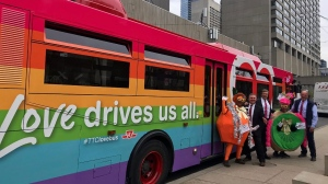 Mayor John Tory is pictured alongside the TTC's Pride Bus for Pride Month. (SOURCE: Pride Toronto)