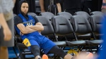 Golden State Warriors' Stephen Curry sits beside the court at practice for the NBA Finals in Oakland on Wednesday, June 12, 2019. THE CANADIAN PRESS/Frank Gunn