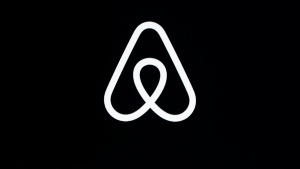 "FILE - This Feb. 22, 2018, file photo shows an Airbnb logo during an event in San Francisco. A lucky few will be able to live the adventures of Phileas Fogg from Jules Vernes' classic ""Around the World in 80 Days."" Hosted by Airbnb, a small number of guests will travel across 16 countries to promote a new collection of available bookings called Airbnb Adventures. (AP Photo/Eric Risberg, File)"