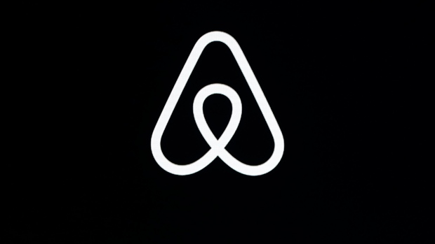 """FILE - This Feb. 22, 2018, file photo shows an Airbnb logo during an event in San Francisco. A lucky few will be able to live the adventures of Phileas Fogg from Jules Vernes' classic """"Around the World in 80 Days."""" Hosted by Airbnb, a small number of guests will travel across 16 countries to promote a new collection of available bookings called Airbnb Adventures. (AP Photo/Eric Risberg, File)"""