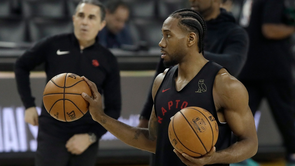 Toronto Raptors forward Kawhi Leonard prepares to shoot during a team practice in Oakland, Calif., Wednesday, June 12, 2019. The Raptors are scheduled to play the Golden State Warriors in Game 6 of basketball's NBA Finals on Thursday. (AP Photo/Jeff Chiu)