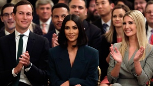White House senior adviser Jared Kushner and Ivanka Trump, right, sit with Kim Kardashian, who is among the celebrities who have advocated for criminal justice reform, as they listen to President Donald Trump speak about second chance hiring in the East Room of the White House, Thursday June 13, 2019, in Washington. (AP Photo/Evan Vucci)