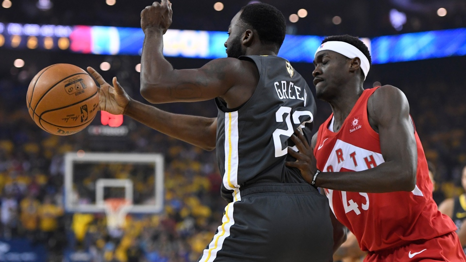 Golden State Warriors forward Draymond Green (23) and Toronto Raptors forward Pascal Siakam (43) battle for control of the ball during first half basketball action in Game 6 of the NBA Finals in Oakland, Calif., on Thursday, June 13, 2019. THE CANADIAN PRESS/Frank Gunn