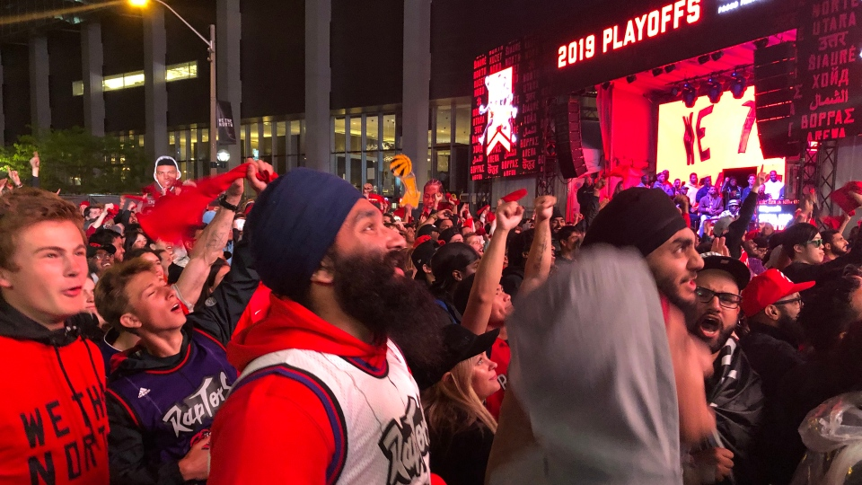 Raptors fans watch Game 6 of the NBA playoffs against the Golden State Warriors at Jurassic Park in downtown Toronto Thursday June 13, 2019. (Corey Baird)
