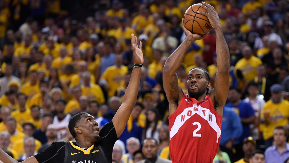 Toronto Raptors forward Kawhi Leonard (2) shoots over Golden State Warriors centre Kevon Looney (5) during second half basketball action in Game 6 of the NBA Finals in Oakland, Calif. on Thursday, June 13, 2019. THE CANADIAN PRESS/Frank Gunn