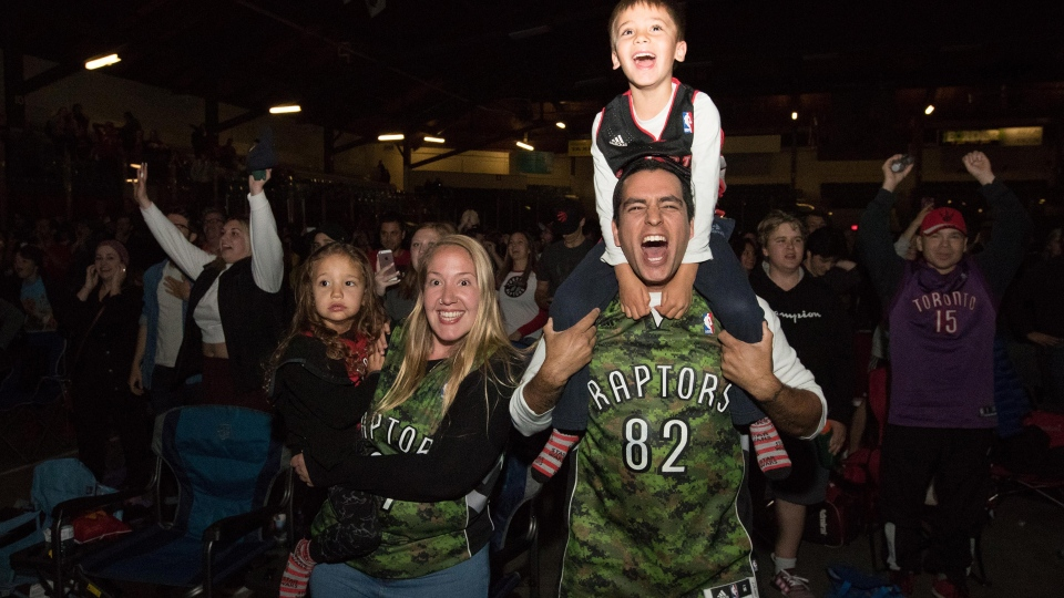 Toronto Raptors fans celebrate after the Raptors beat the Golden State Warriors with 114-110 in game 6 NBA Finals action to win the NBA Championship at a viewing party inside the Memorial Centre in Kingston, Ont., Thursday, June 13, 2019. THE CANADIAN PRESS/Lars Hagberg