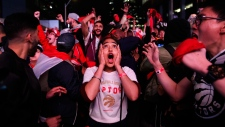 A fan reacts in Jurassic Park as the Toronto Raptors defeat the Golden State Warriors during Game 6 NBA Finals to win the NBA Championship, in Toronto on Thursday, June 13, 2019. THE CANADIAN PRESS/Nathan Denette