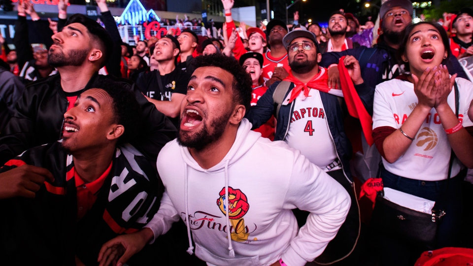 Fans reacts in the finals minute of the game in Jurassic Park as the Toronto Raptors defeat the Golden State Warriors during Game 6 NBA Finals to win the NBA Championship, in Toronto on Thursday, June 13, 2019. THE CANADIAN PRESS/Nathan Denette