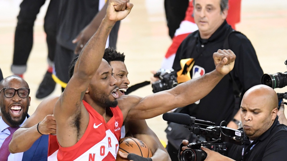 Toronto Raptors forward Kawhi Leonard (2) and Toronto Raptors guard Kyle Lowry, centre back, celebrate defeating the Golden State Warriors basketball action in Game 6 of the NBA Finals in Oakland, Calif. on Thursday, June 13, 2019. Raptors have won their first NBA title in franchise history. THE CANADIAN PRESS/Frank Gunn