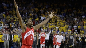 Toronto Raptors forward Kawhi Leonard celebrates after the Raptors defeated the Golden State Warriors in Game 6 of basketball's NBA Finals in Oakland, Calif., Thursday, June 13, 2019. (AP Photo/Ben Margot)
