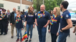 Caroline Mulroney, Doug Ford and Christine Elliott are seen wearing Pride shirts in Newmarket on June 15, 2019. (Tracy Tong/CTV News Toronto)