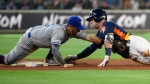 Houston Astros' Alex Bregman, right, is tagged out by Toronto Blue Jays second baseman Eric Sogard  after trying to stretch an RBI single into a double during the fourth inning of a baseball game, Saturday, June 15, 2019, in Houston. (AP Photo/Eric Christian Smith)