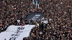 "Protesters carry a huge banner that reads ""Our hearts are torn to pieces. Withdraw the monstrous bill"" as they march on the streets against an extradition bill in Hong Kong on Sunday, June 16, 2019. Hong Kong residents Sunday continued their massive protest over an unpopular extradition bill that has highlighted the territory's apprehension about relations with mainland China, a week after the crisis brought as many as 1 million into the streets. (AP Photo/Vincent Yu)"