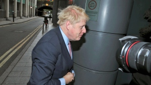 Conservative Party leadership contender Boris Johnson arrives for the Conservative National Convention meeting in central London, Saturday June 15, 2019. Britain's Conservative Party is holding a contest to replace Prime Minister Theresa May, and party legislators will continue to hold elimination votes until the final two contenders will be put to a vote of 160,000 Conservative Party members nationwide, with the winner due to become Conservative Party leader and prime minister late July. (Yui Mok/PA via AP)