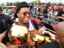 Toronto Raptors guard Kyle Lowry holds the Larry O'Brien Championship Trophy during the 2019 Toronto Raptors Championship parade in Toronto on Monday, June 17, 2019. THE CANADIAN PRESS/Frank Gunn