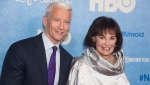 "FILE - In this April 4, 2016 file photo, CNN anchor Anderson Cooper and Gloria Vanderbilt attend the premiere of ""Nothing Left Unsaid"" at the Time Warner Center in New York. Vanderbilt, the ""poor little rich girl"" heiress at the center of a scandalous custody battle of the 1930s and the designer jeans queen of the 1970s and '80s, died on Monday, June 17, 2019, at 95, according to her son, Cooper. (Photo by Charles Sykes/Invision/AP, File)"