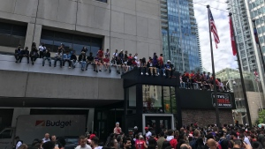 Fans try to get a good vantage point of the Raptors parade near University Avenue and Richmond Street. (Scott Lightfoot/ CP24)