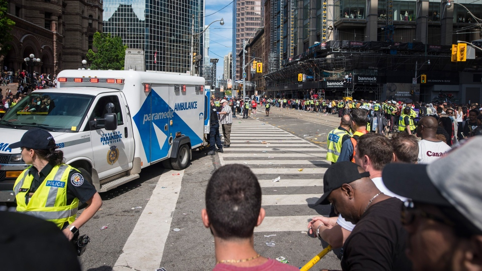 An ambulance arrives to the scene after shots were fired during the Toronto Raptors NBA Championship victory celebration near Nathan Phillips Square in Toronto on Monday, June 17, 2019. THE CANADIAN PRESS/ Tijana Martin