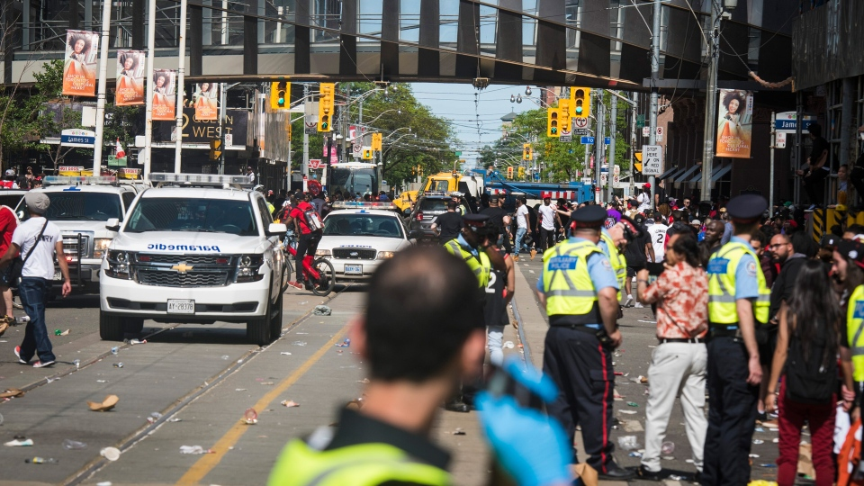 First responders make their way along Queen Street West after reports of shots fired during the Toronto Raptors NBA Championship victory celebration near Nathan Phillips Square in Toronto on Monday, June 17, 2019. THE CANADIAN PRESS/ Tijana Martin