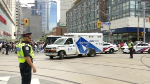Paramedics respond to the scene of a stabbing in the area of Bay and Dundas streets Monday June 17, 2019. (Pascal Marchand)