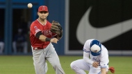 Toronto Blue Jays' Cavan Biggio, right, gets caught out on the force out at second base as Los Angeles Angels' Tommy La Stella turns the double play during seventh inning American League MLB baseball action in Toronto, Monday, June 17, 2019. THE CANADIAN PRESS/Fred Thornhill