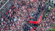 Fans cheer as the Toronto Raptors pass by during the 2019 Toronto Raptors Championship parade in Toronto, on Monday, June 17, 2019. THE CANADIAN PRESS/Andrew Lahodynskyj