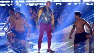 Dwayne Johnson, also known as The Rock, center, accepts the generation award at the MTV Movie and TV Awards on Saturday, June 15, 2019, at the Barker Hangar in Santa Monica, Calif. (Photo by Chris Pizzello/Invision/AP)
