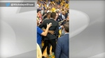 Raptors President Masai Ujiri is seen in the stands at the Oracle Arena in Oakland on June 13 after an alleged altercation with a sheriff's deputy who demanded to see his NBA credentials.
